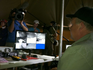 Lee Berger watches the live feed from cameras 30 metres below ground. Photo by ANDREW HOWLEY, NATIONAL GEOGRAPHIC