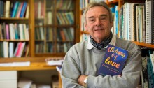 World renowned Insect conservationist Prof. Michael Samways with a copy of his new book on love and happiness. Photo: Stefan Els/SU
