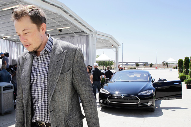 Elon Musk and the Tesla. Source: Flickr user CyberHades