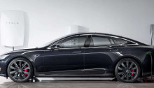 Elon Musk's Powerwall battery, to the left. Photo credit: www.teslamotors.com