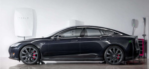 Elon Musk's Powerwall battery, to the left. Photo credit: www.teslamotors.com
