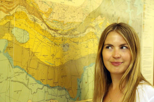 Dr Katie Smart and a historical map of the Witwatersrand Gold Fields. Credit: Wits University