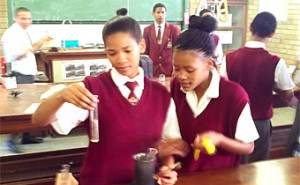 Janethon de Klerk (18, left) conducting a science experiment with a fellow learner at Carnarvon High School.