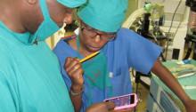 Photo credit: The Phone Oximeter in use in Uganda. Credit: www.phoneoximeter.org/